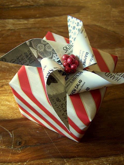 Idea.. Pinwheel instead of bow on christmas wrapping. Wrapping Santa presents tonight!
