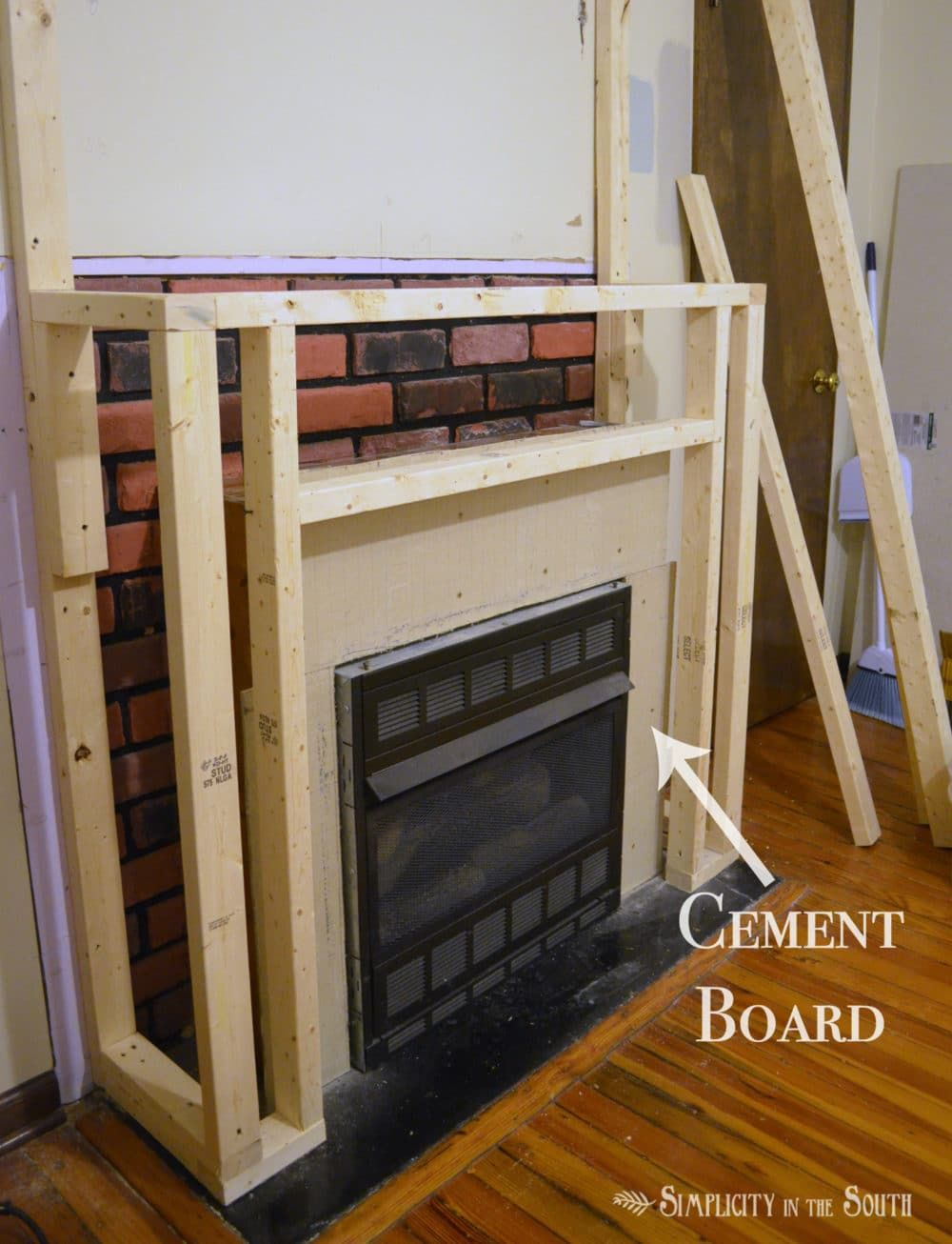 Crown Molding Fireplace. A fireplace is given a farmhouse style makeover using plywood  crown molding quartz ledge