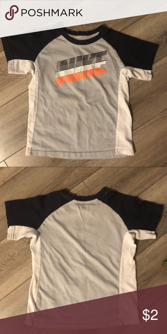 e0e2d2f5 Nike T-shirt Boys Size 6 Navy blue, orange, gray and white- Pre worn Boys  Nike T-Shirt Size 6. No stains but gently used condition. Nike Shirts & Tops  Tees ...