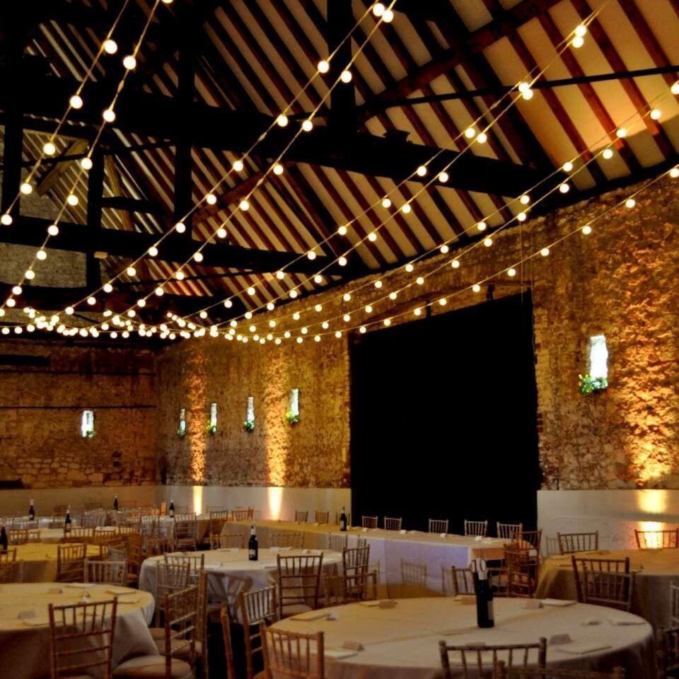 Lights Create A Magical Effect For A Barn Wedding.