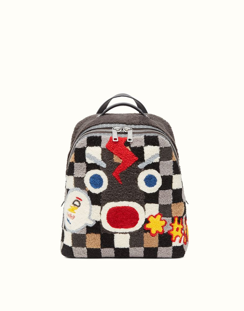 7e687cbed332 Roomy square backpack made from Merino sheepskin with checkerboard inlay  and the Fendi Faces
