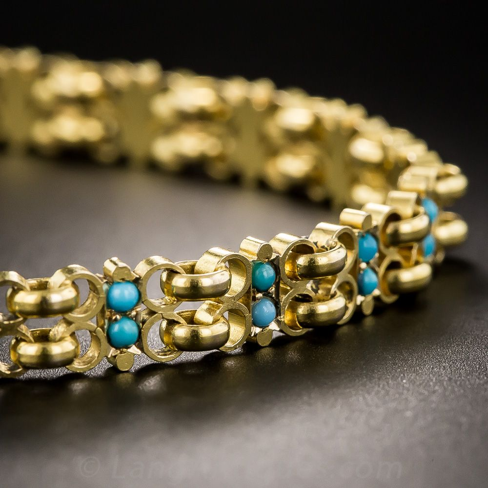 18K Yellow Gold Turquoise Bracelet. -fabricated in sumptuous 18 karat gold, pairs of tiny turquoise cabochons dot the links of this 7 1/2 inch-long bracelet.