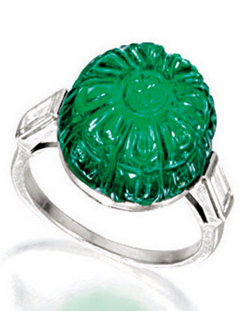 EXQUISITE ART DECO EMERALD AND DIAMOND RING, CIRCA 1925, Cartier. Centring on a carved cabochon emerald weighing approximately 19.00 carats, flanked on each side by a baguette diamond, mounted in platinum, signed and numbered. #Cartier  #ArtDeco #ring