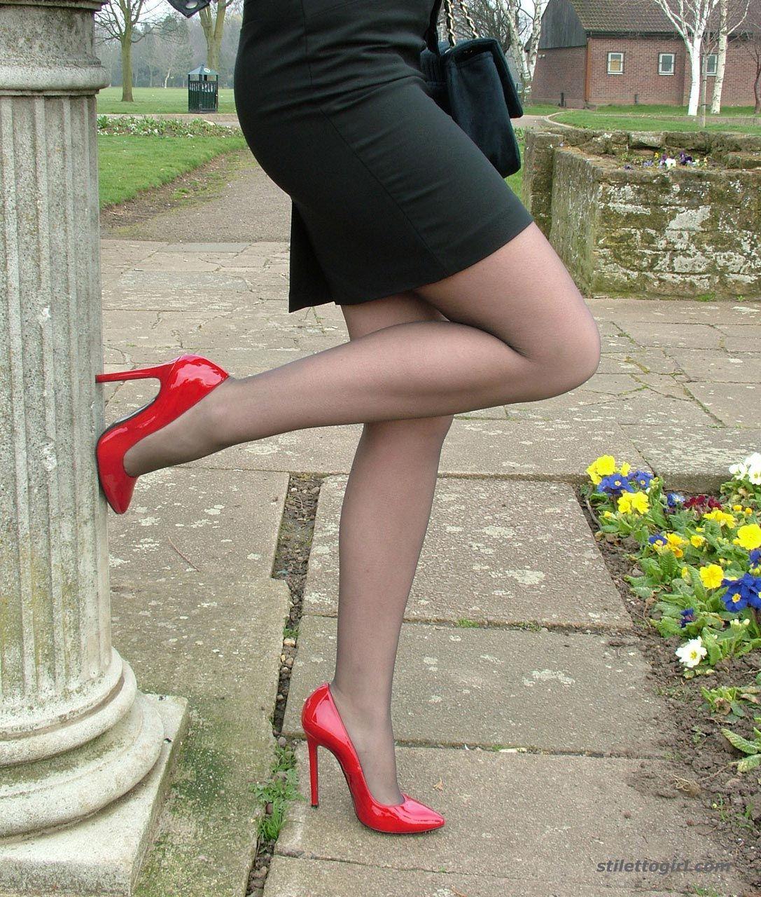 Red Stiletto Heels Showing Leg