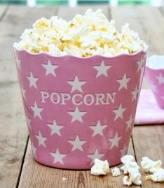 Pink popcorn bowl with stars by Danish brand- Krasilnikoff.
