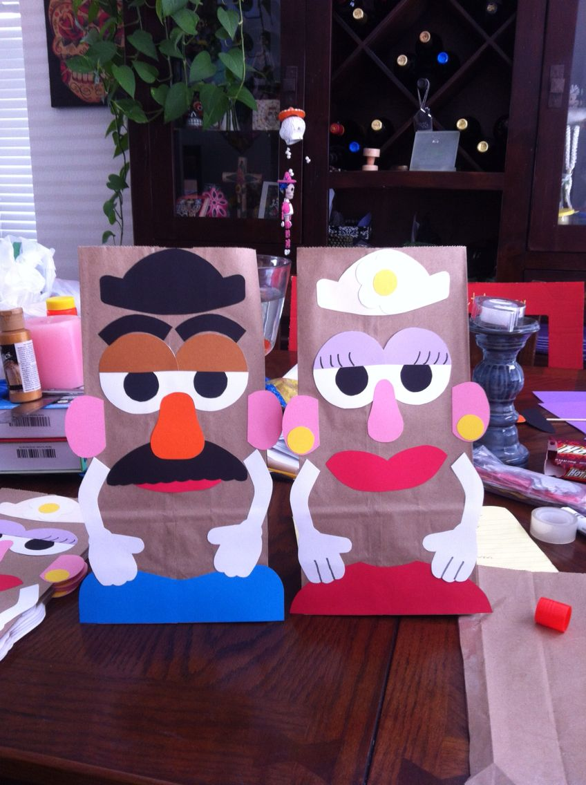 Homemade (freehand) Mr. And Mrs. Potato Head goody bags for a Toy Story party. Paper bags from the Dollar store and card stock on hand.