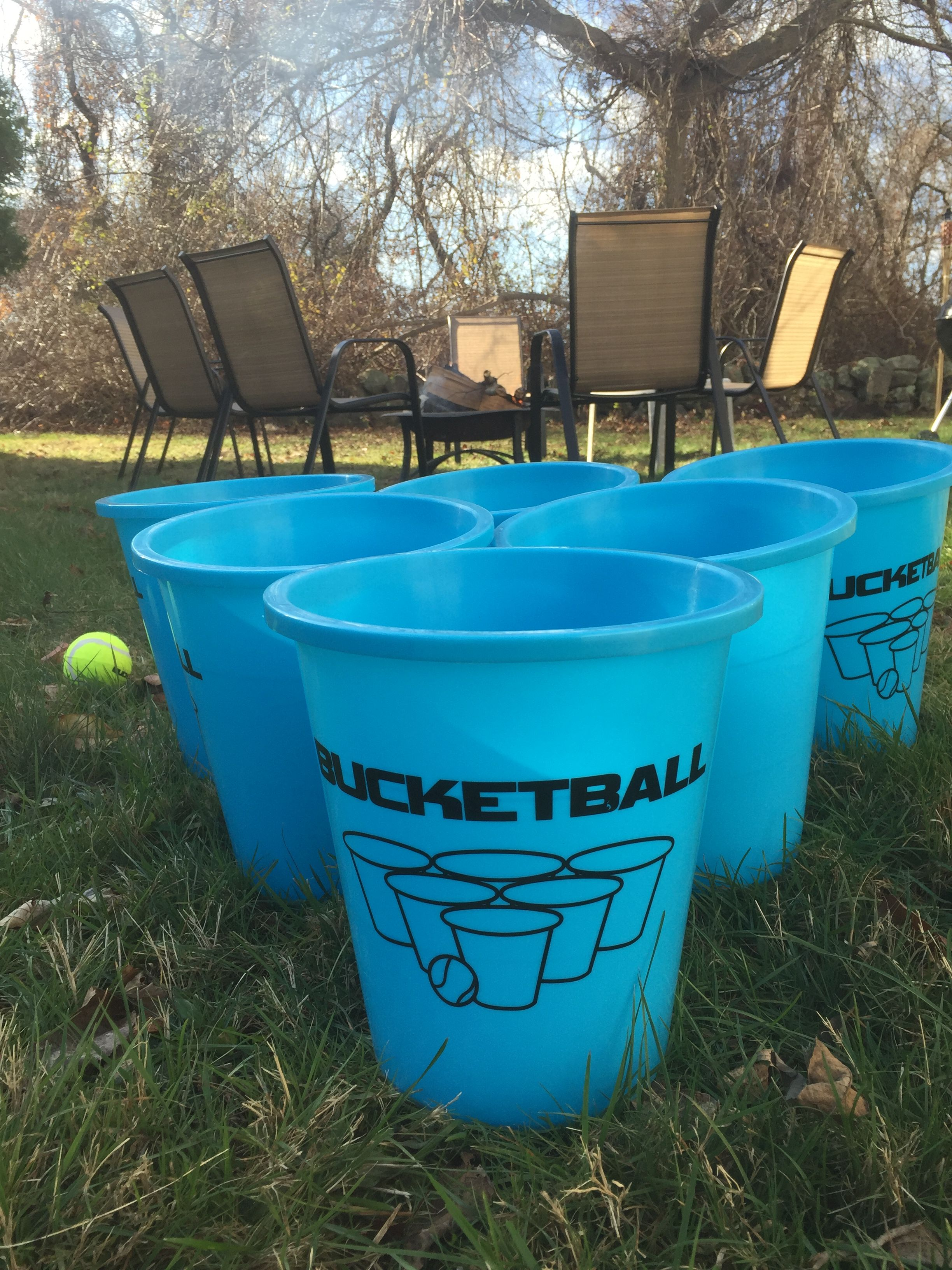 bucketballa by the fire pit a great game to play in your backyard