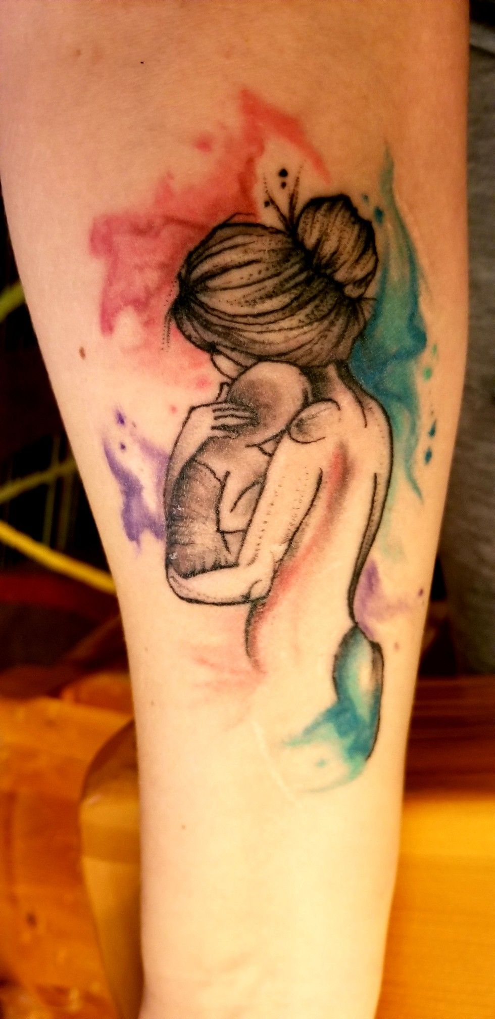 Mother holding baby in arms with watercolor effect