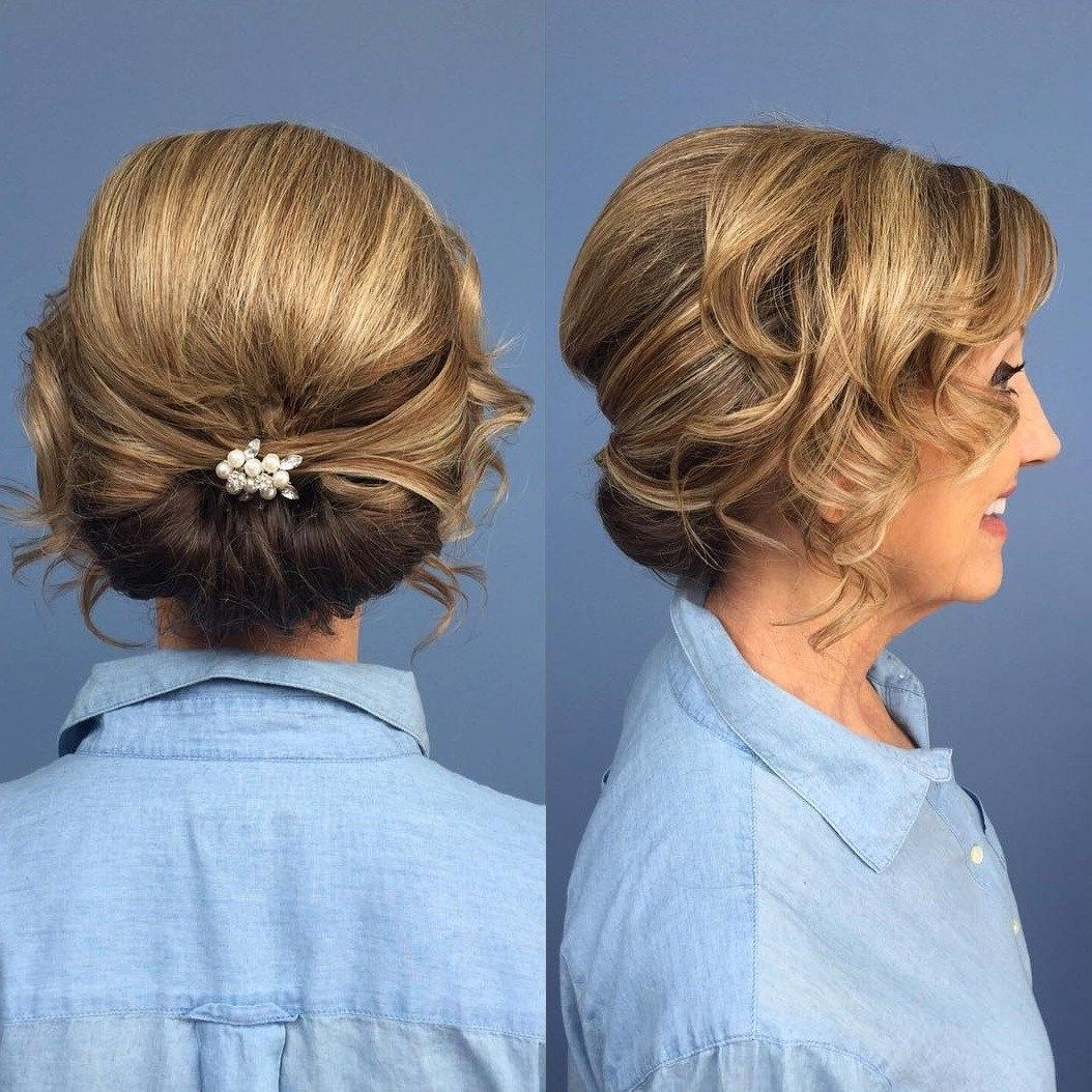 Mother Of The Bride Low Roll Updo Mother Of The Groom Hairstyles Mother Of The Bride Hair Medium Length Hair Styles