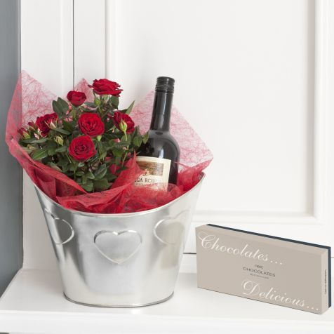 Red Wine Gift Set, with a mini red rose bush to plant! - could easily diy this! love the idea of gifting a bush instead of a bouquet, esp. if the recipient is into gardening or sustainability #valentines