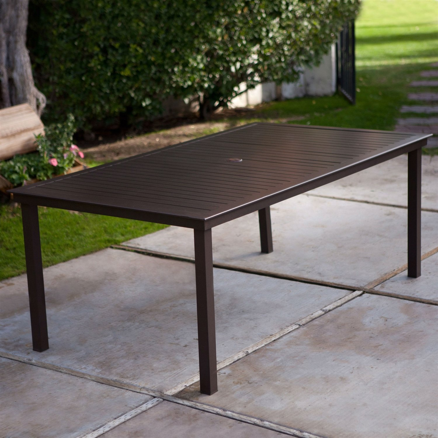 Rectangular 74 x 42 inch patio dining table in mocha brown with center umbrella hole
