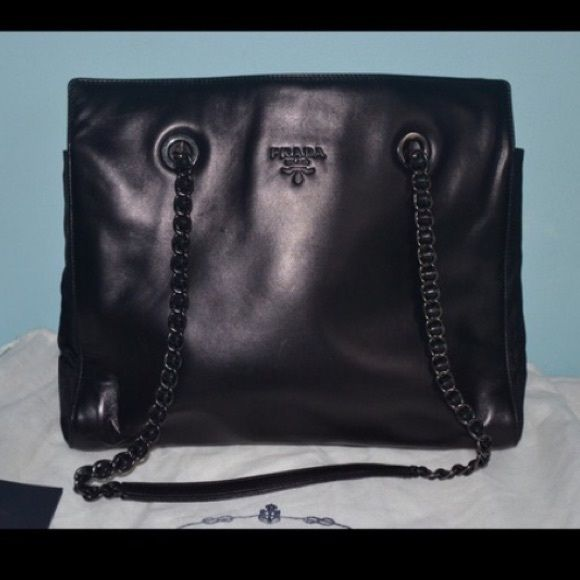 """Authentic Vintage Prada Leather Bag Black authentic vintage Prada bag, with card of authenticity included. Only used once & in great condition!! Leather straps and chain. 2 sections on inside and zipper in the middle. 10"""" tall, 12"""" across, 5"""" thick. Prada Bags Totes"""