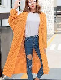 Kuvahaun tulos haulle oranssi pitkä neuletakki