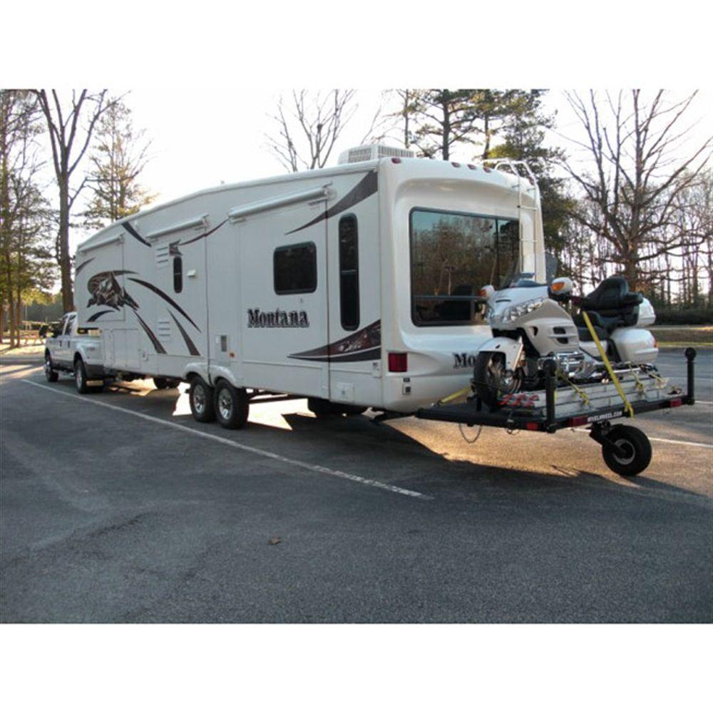 04d9b14d9c A Swivelwheel single wheel trailer hauling a motorcycle behind a 5th wheel  camper