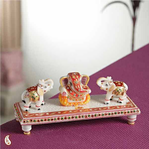 Chowki Ganesh With Elephants - A Beautiful creation of Lord Ganesh seated on a marble chowki that has been hand crafted with pure 22 carat gold leaf work and studded with white, red and green crystals, and guarded on either side with two miniature elephants praising the Lord..  http://www.indiaplaza.com/chowki-ganesh-with-elephants-handicrafts-han15032012apr113-10.htm?utm_medium=social-media_campaign=Pinterest+daily+updates_source=Pinterest