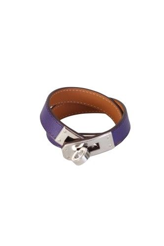 "Brand: Hermes Style: Kelly double tour bracelet Size: XS Color: Purple Material: Anemone swift calfskin Hardware: Palladium Measurements: L 13.5"", D 2"", W .5 Origin: France Serial Number: FL N square Includes: Original box & dustbag Condition: New in box, plastic is still on the hardware Retail: $550 +tax"
