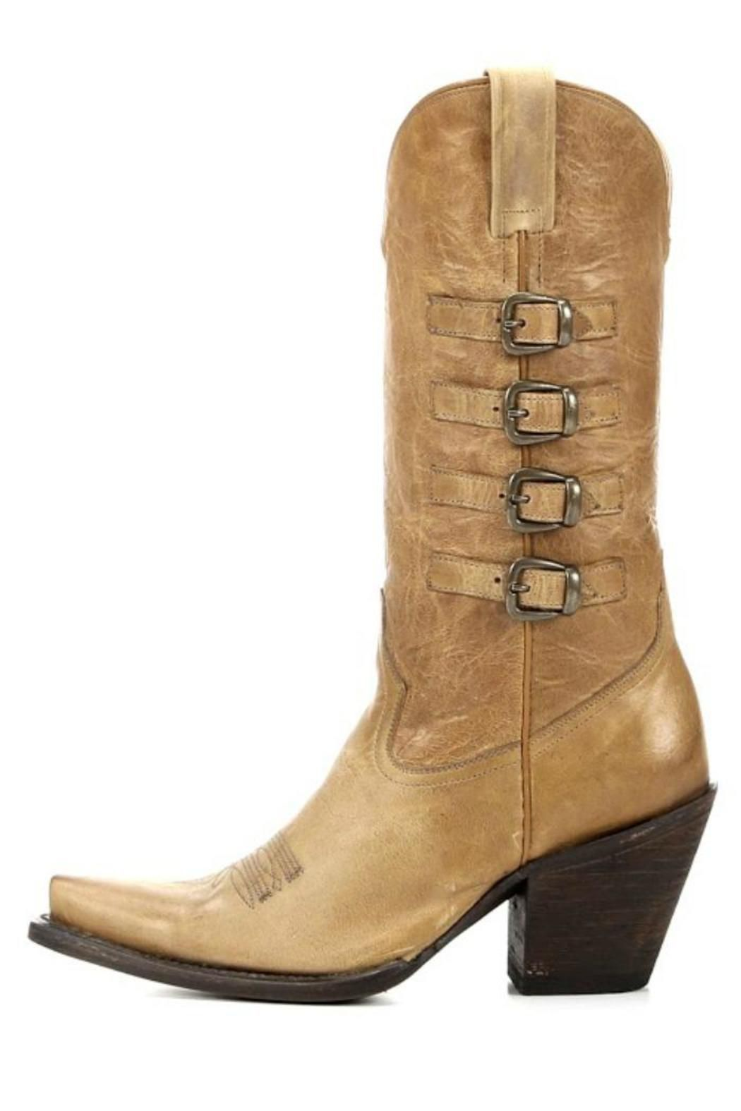 """Four side buckles, distressed tan leather and a tall fashion heel. The Vivienne Buckle Boot easily adds depth to your style and pairs nicely with most outfits. Shaft Height: 11 1/2""""Toe: Snip Heel Height: 3 1/4""""Cushion Insole Leather Outsole Goodyear Welt Construction Shaft Circumference: 13""""on size 7 (measurement varies by size)   Vivienne Buckle Boot by American Rebel Boot Company. Shoes - Boots Ohio"""