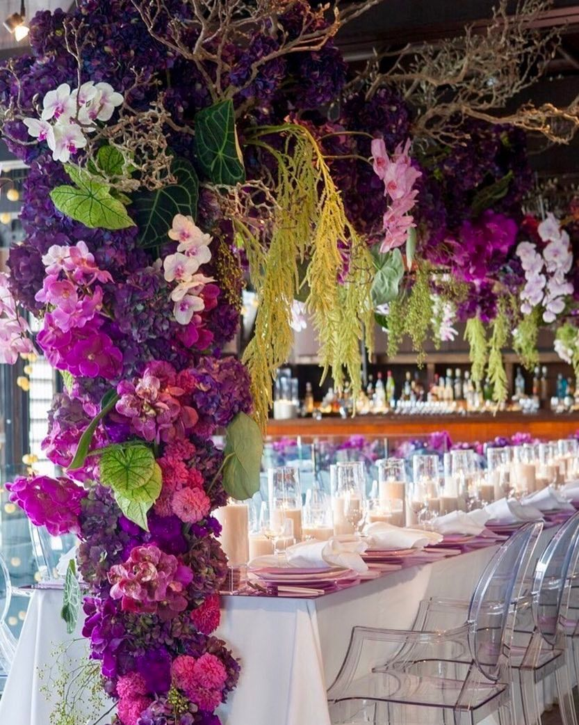 Pink and maroon wedding decor  Tablescapes were styled with bespoke pink mirror tabletops