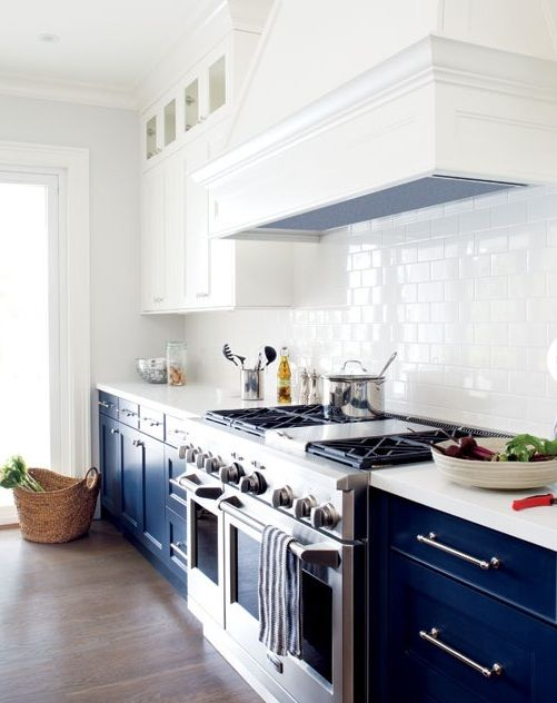 kitchen with bright navy blue cabinets on the bottom and crisp white ...