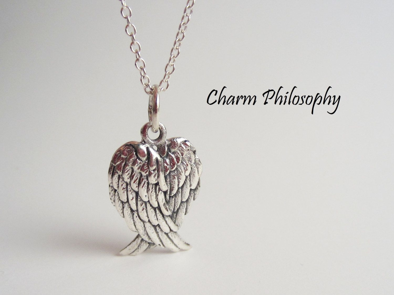 Angel wings necklace 925 sterling silver folded wings pendant angel wings necklace 925 sterling silver folded wings pendant griever necklace grief aloadofball Image collections