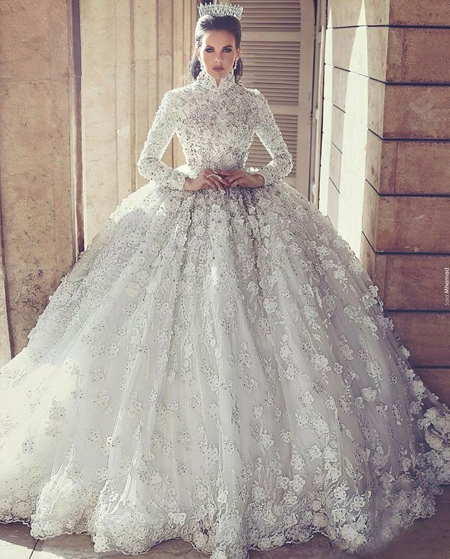 This Dramatic Ball Gown From Mayada Sahmarani Houte Couture Featuring Jewel Embellishments And Unique Detailing Is Incredibly Stunning High Neck Wedding Dress Bridal Ball Gown High Neck Long Sleeve Wedding Dress