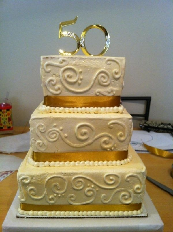 Golden anniversary cake...replace this topper with the couple\'s ...