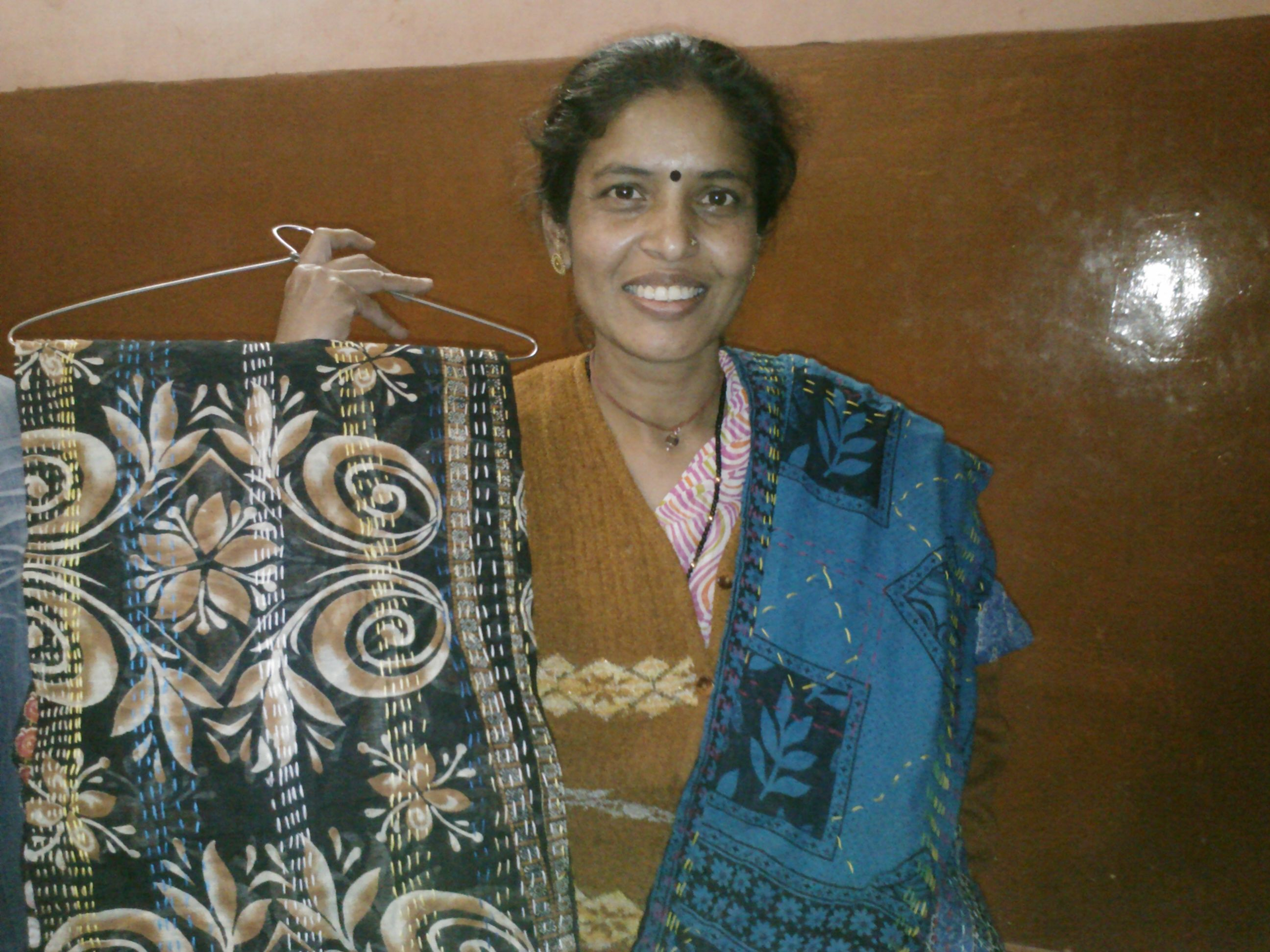 Laxmi with finished Kantha Scarf....hand stitched and ready to ship to Paris, ON, Canada.