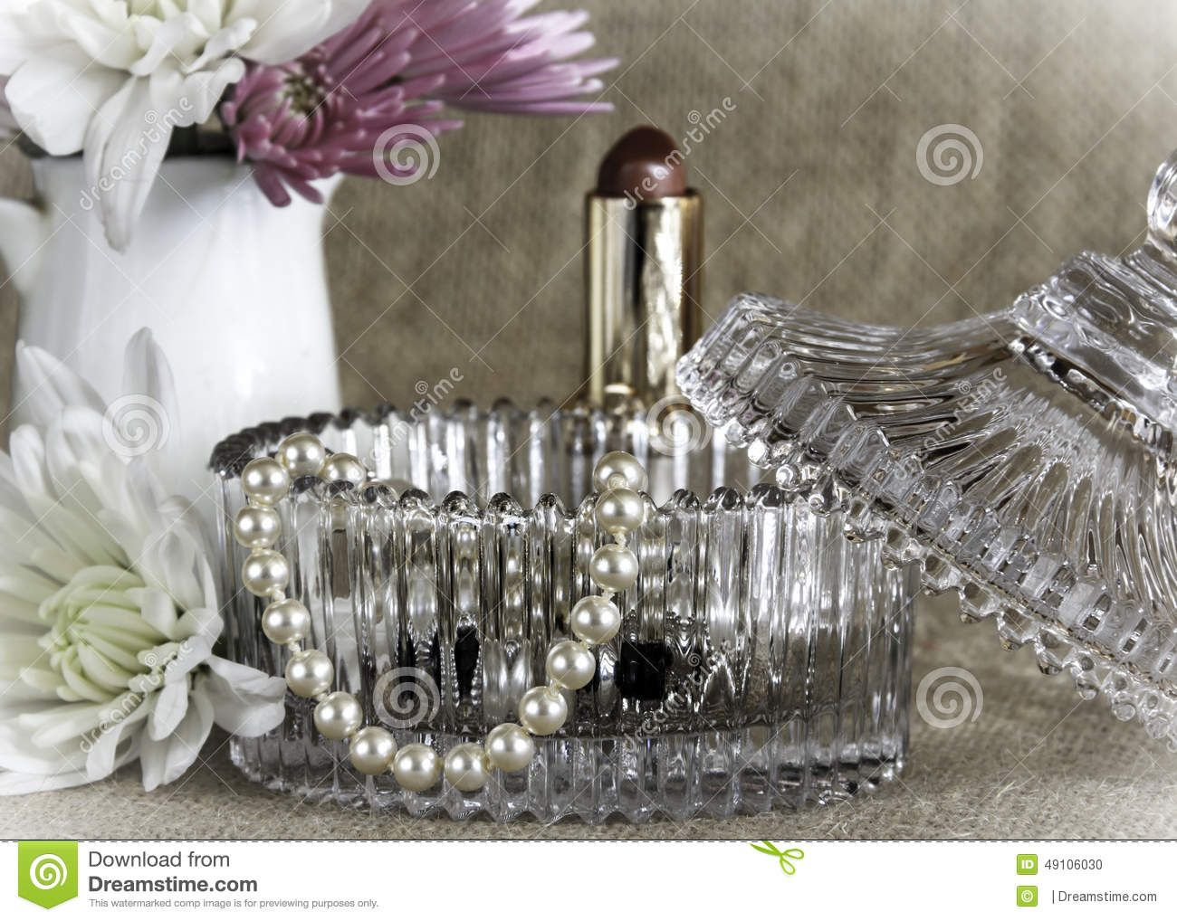 A display of a Trinket Jar and Pink Flower placed on a hessian background