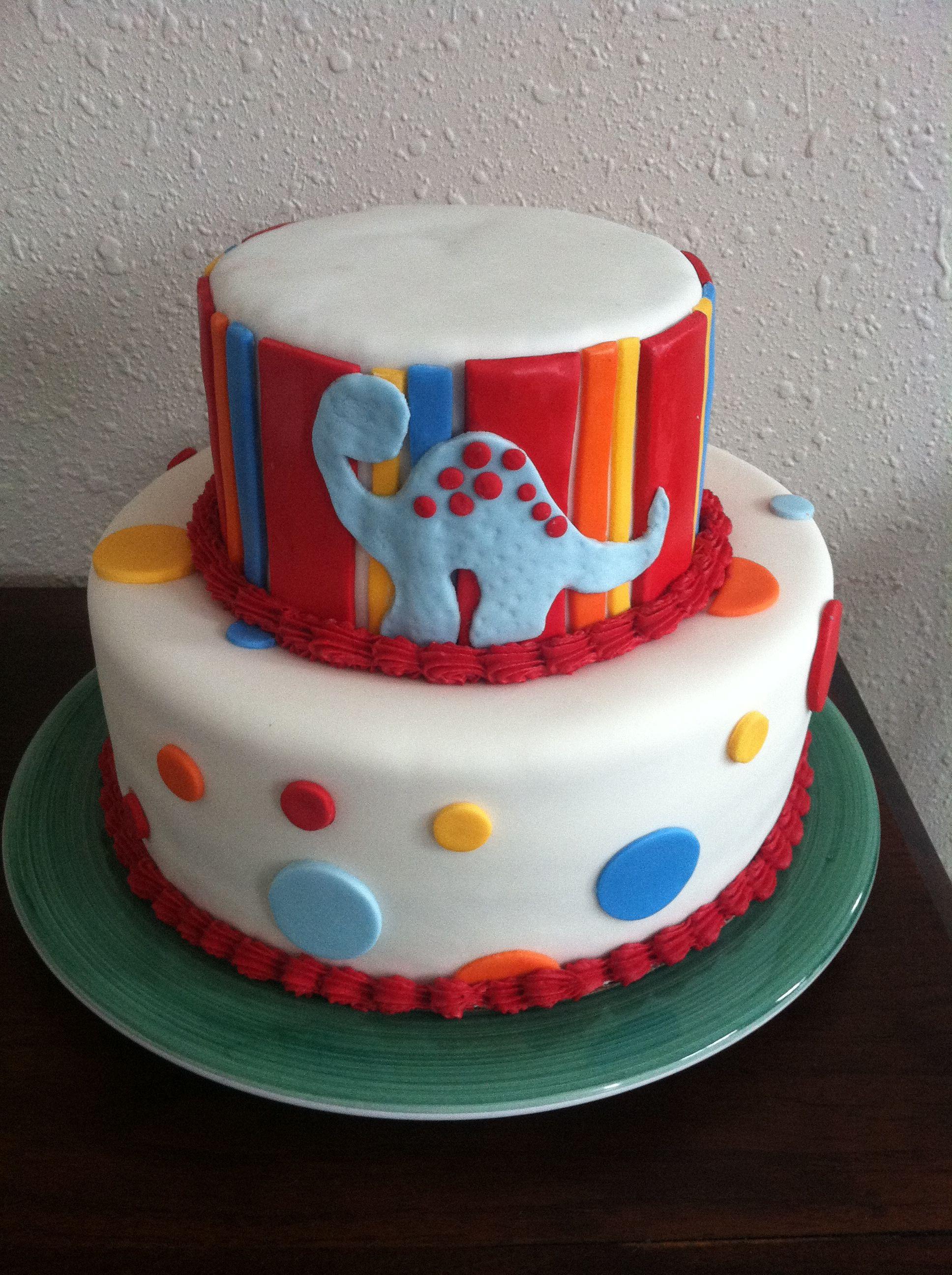 A cute dinosaur cake for a baby boy shower.