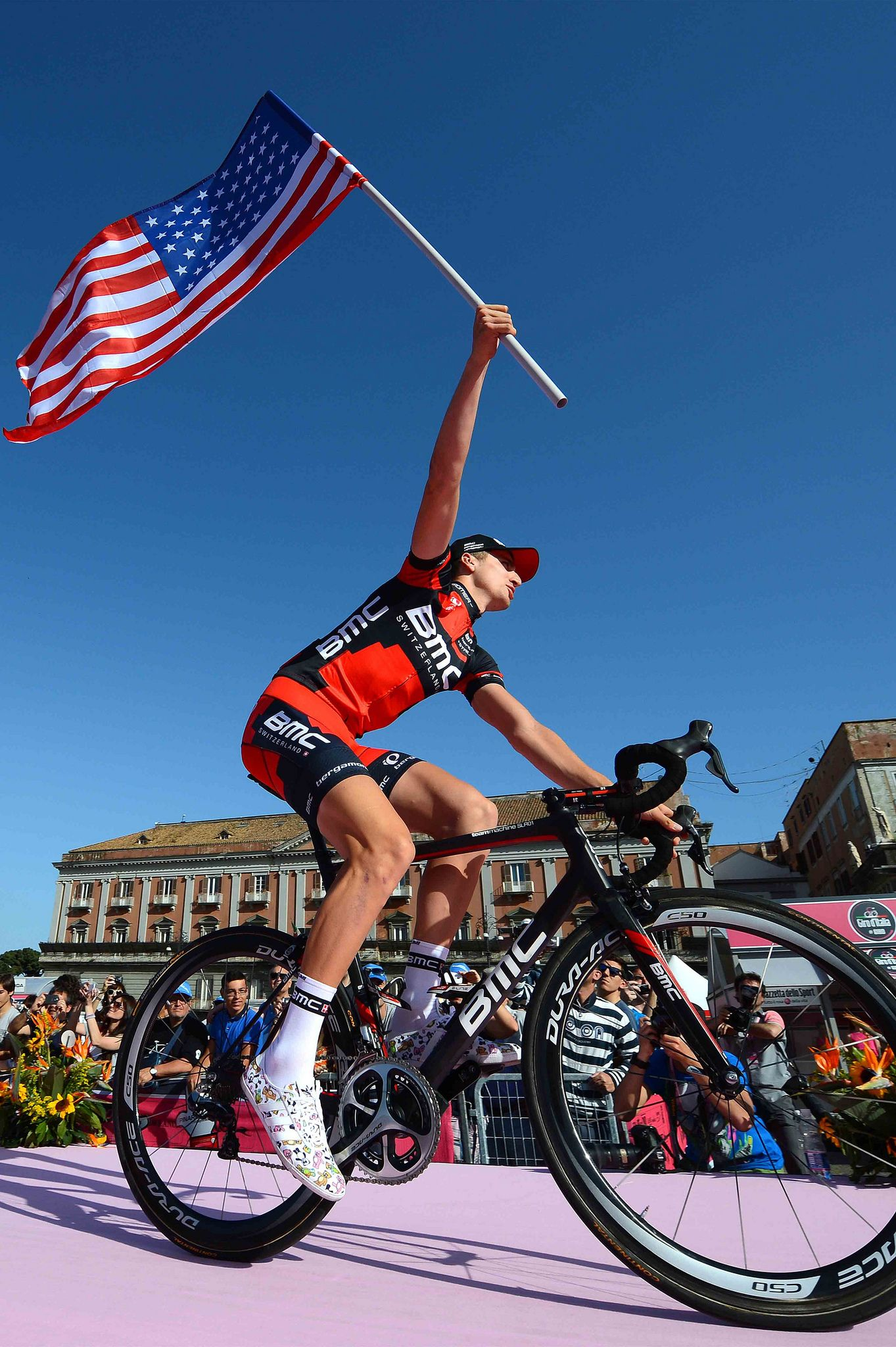 Giro2013 Phinney Of Bmc Waving The Flag At The Teams Presentation Ride Bicycle Cycling Photos Track Bike