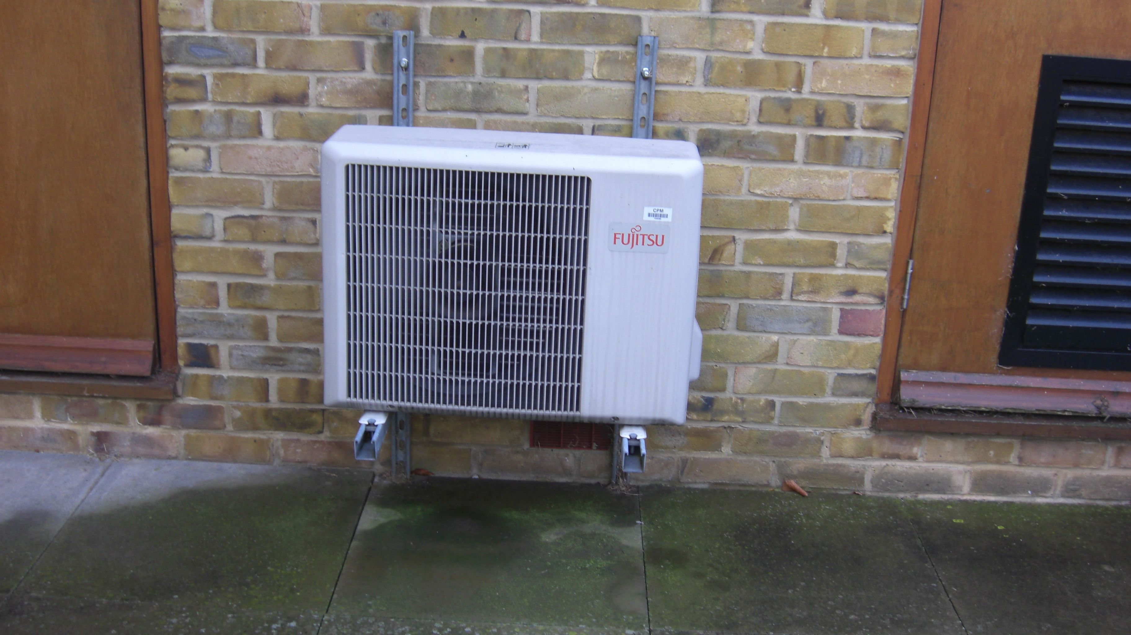 Air conditioning condensing unit looks clean from the