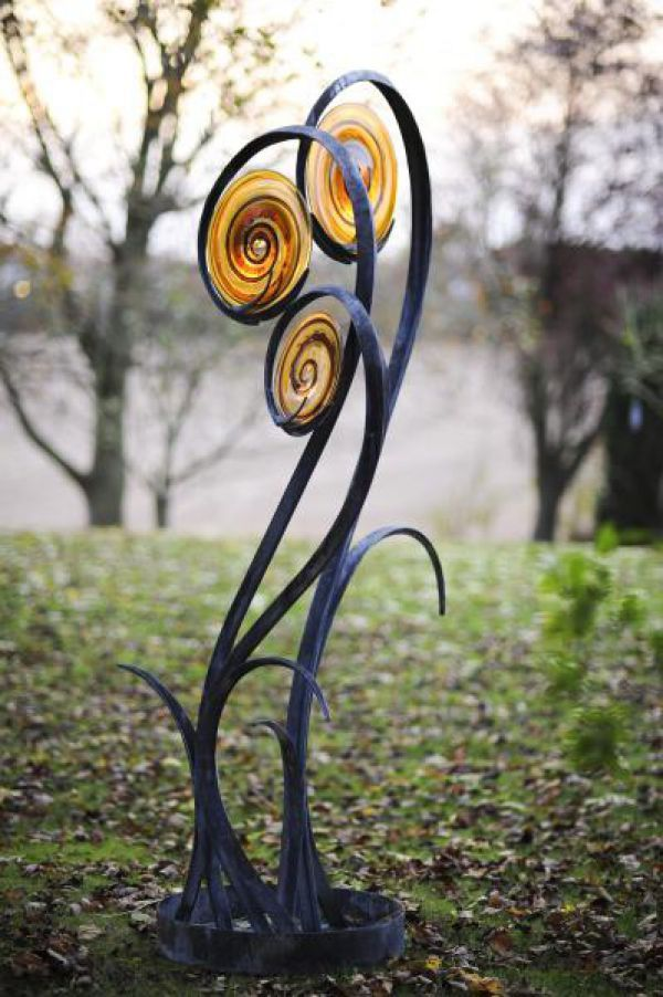 Forged Steel And Blown Glass Garden Or Yard Outside And Outdoor Sculpture By Artist Jenny Pickford Titled Unfurl Outsize Steel And Glass Flower Plant