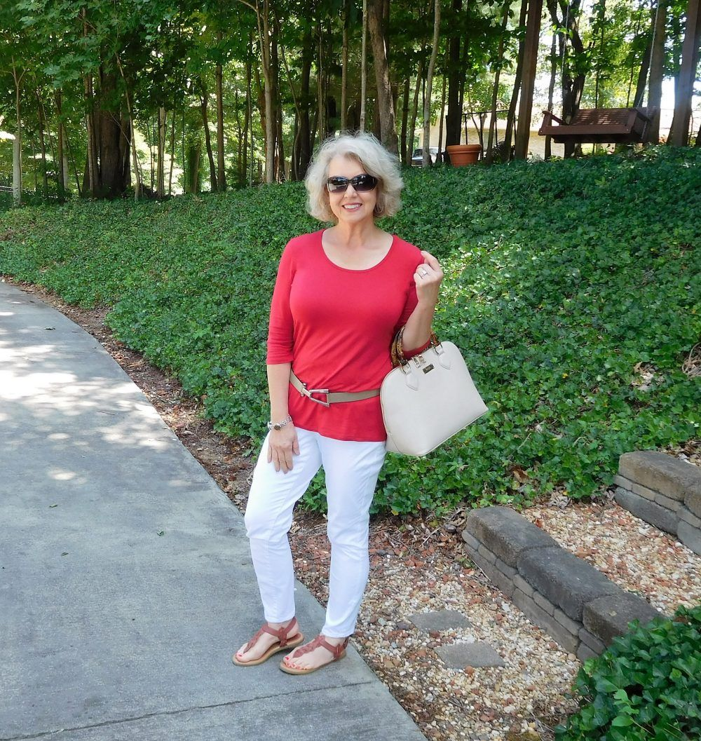 For a casual family gathering at my sister's home I wore white pants with a  top and flat sandals with a strap that goes around the heel. Wearing a belt in this way with a tunic and flats helps to break my body into thirds instead of in half. Visually dividing your body in half makes you look shorter and wider.