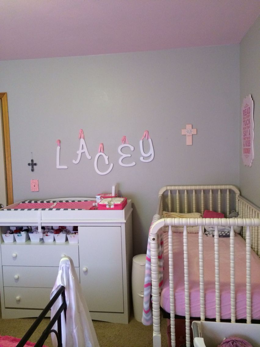 Shared parent room and baby nursery. Pink and grey