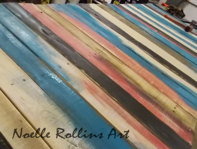 Closeup of the pallet table top.  Different colors of paint, large and oversized for the classroom.