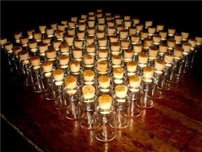 $9.99 FREE SH-LOT OF 50 Clear Cork Glass Bottles Vials 2 ml suggested uses for these small vials: scrap-booking, blood vials, wedding favors, wedding decorations, storage accessories. Material: Pyrex, High borosilicate clear glass , cork lid.