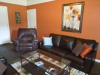 Orange Blue Brown And Green Living Room With Dark Leather Sofas Brown Living Room Decor Living Room Orange Brown And Green Living Room
