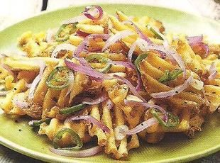 Salt and pepper fries with onion and jalapeno