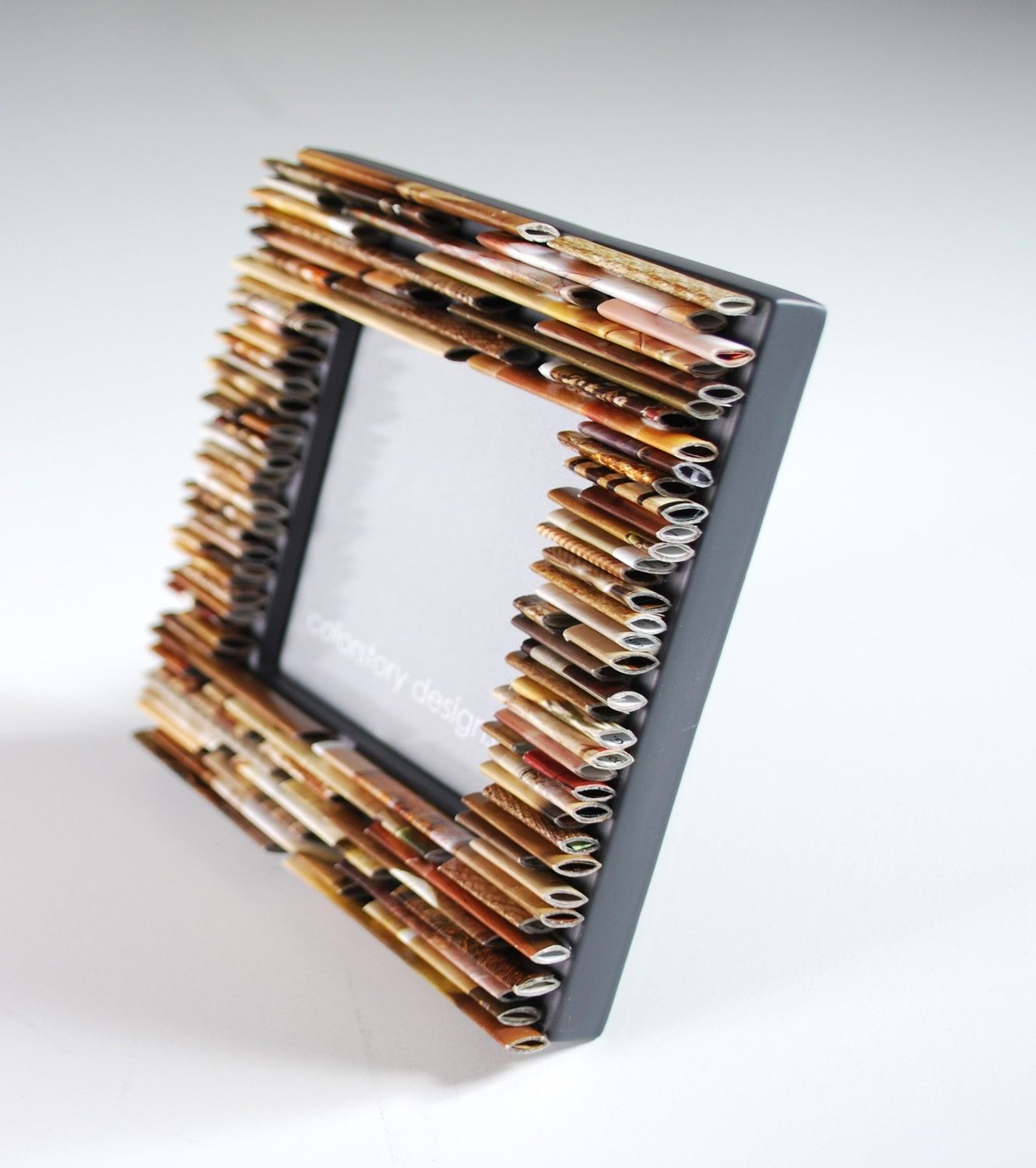 A picture frame made from recycled magazines cool for Cool recycled stuff
