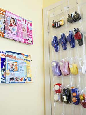 Utilize Space Behind Doors For Storage, another idea from Scrapbook.com.  What a smart way to store punch tools.