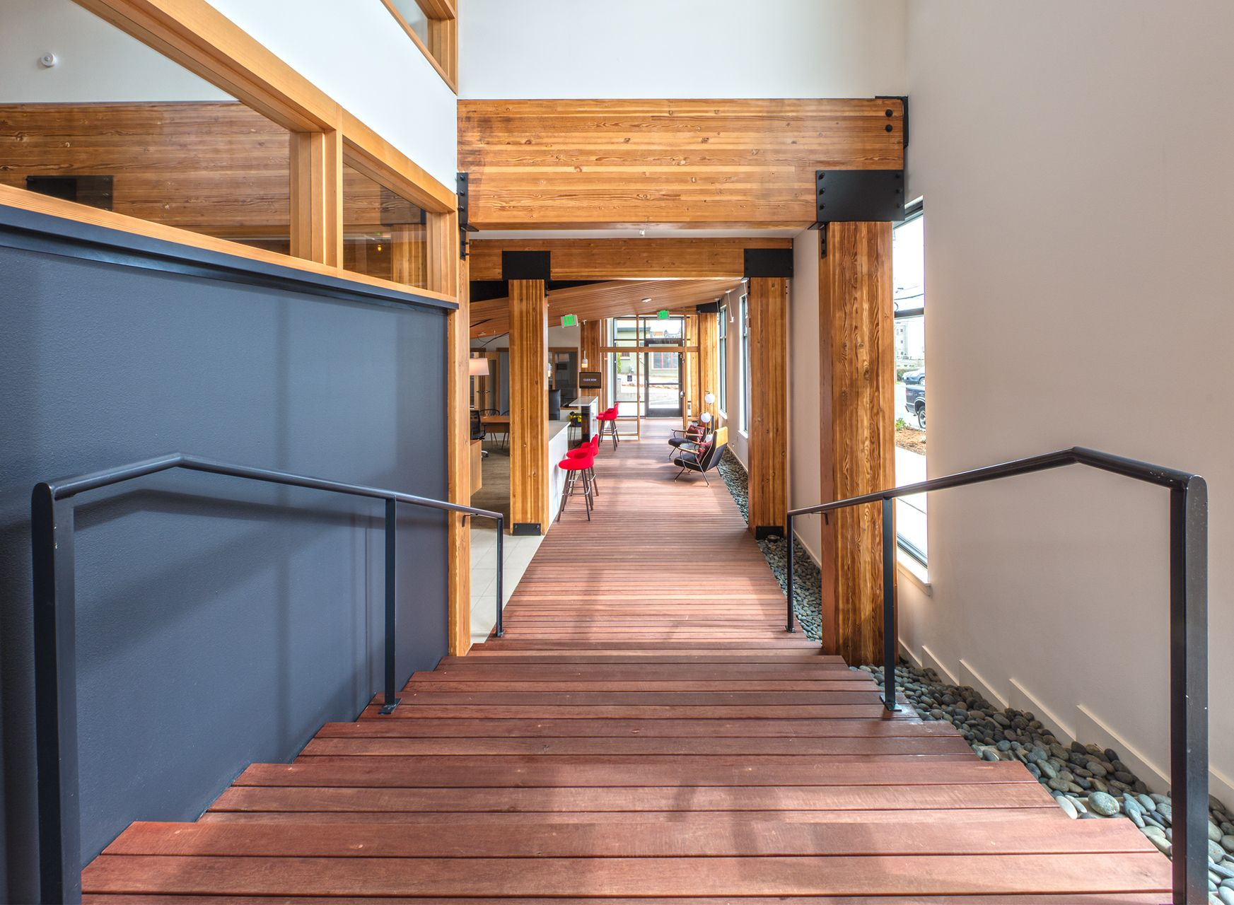 The wood beams are a central design element throughout