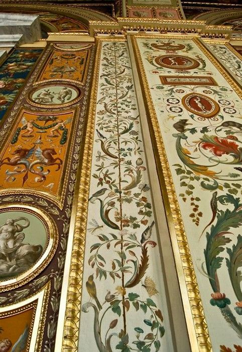 Elaborately painted and gilded vertical panels line the walls at The Hermitage Museum, formerly the Winter Palace, St Petersburg, Russia, ...
