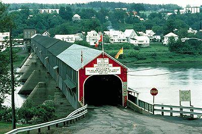 Covered Bridge The worlds longest covered bridge, located at Hartland, New Brunswick (photo by J.A. Kraulis).