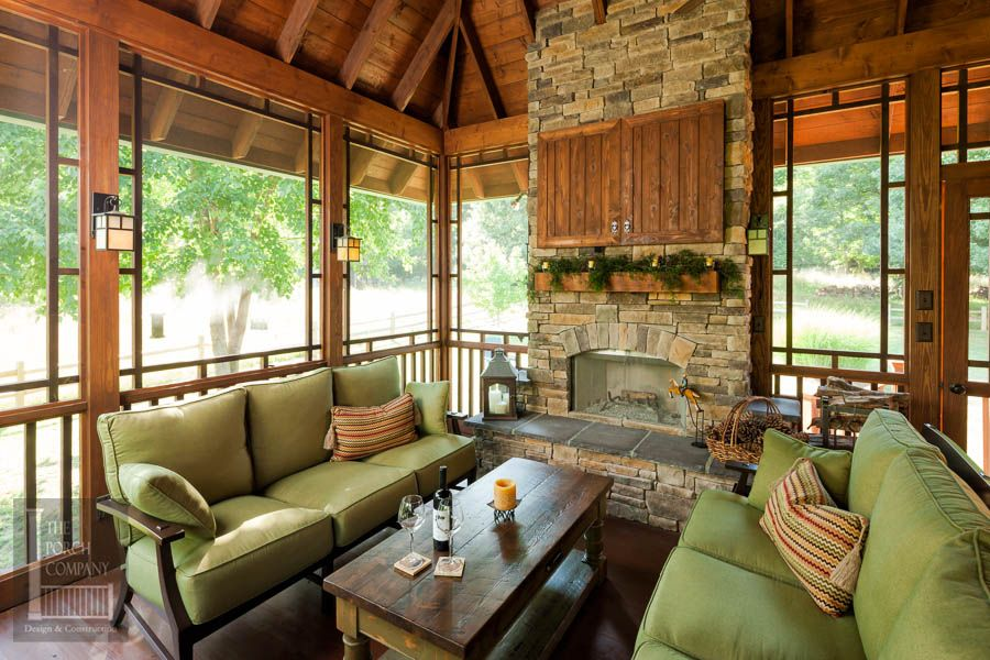 Screened Porch With Fireplace And Exposed Rafter Ceilings