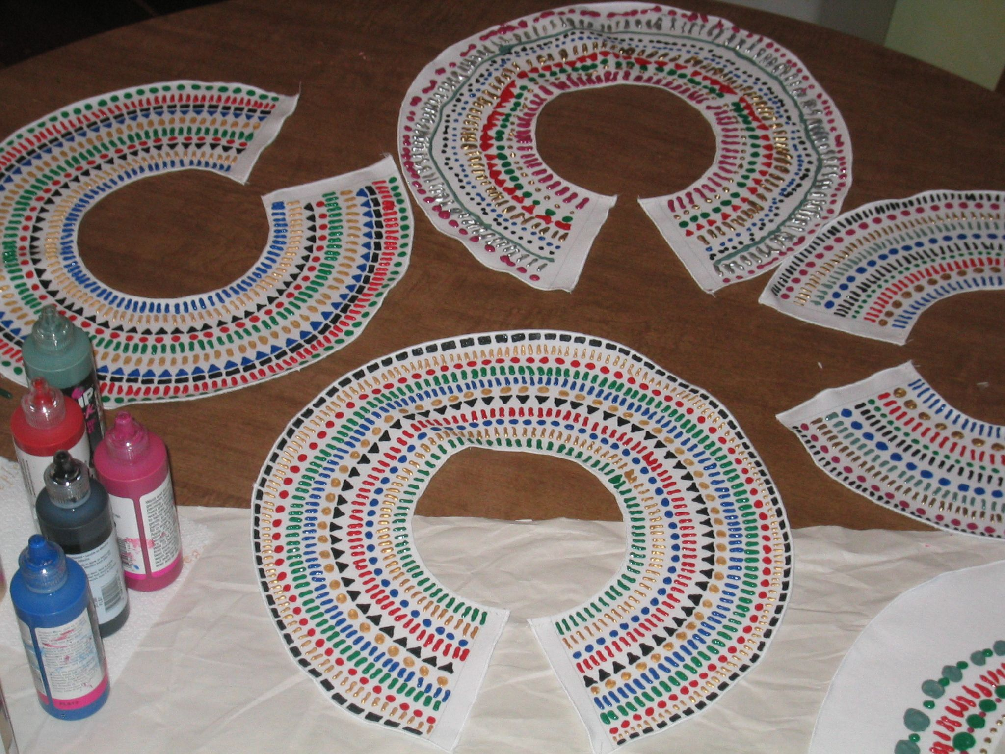 "Egyptian ""beaded"" collars for a Queen of the Nile birthday party.  I sewed white cotton collars, then we decorated with dimensional (""puff"") paint.  April 2006"
