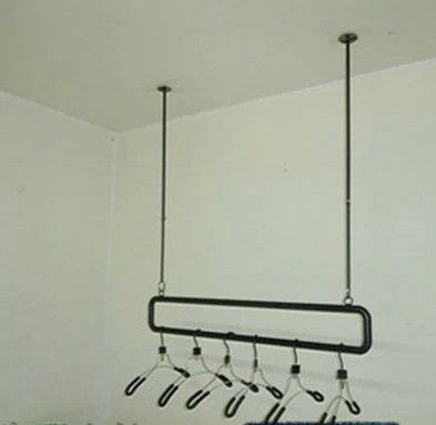 Wall Hangers For Clothes Delectable Wrought Iron Wall Clothing Rack On The Clothing Store Shelves Decorating Design