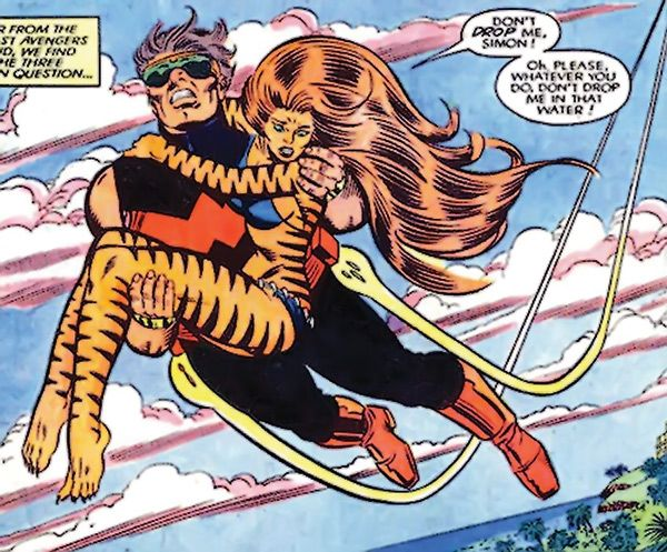 Wonder Man (Simon Williams) takes to the sky with a frightened Tigra in his arms.