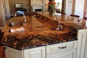 Sedna Granite Or Magma Gold Granite With White Cabinets