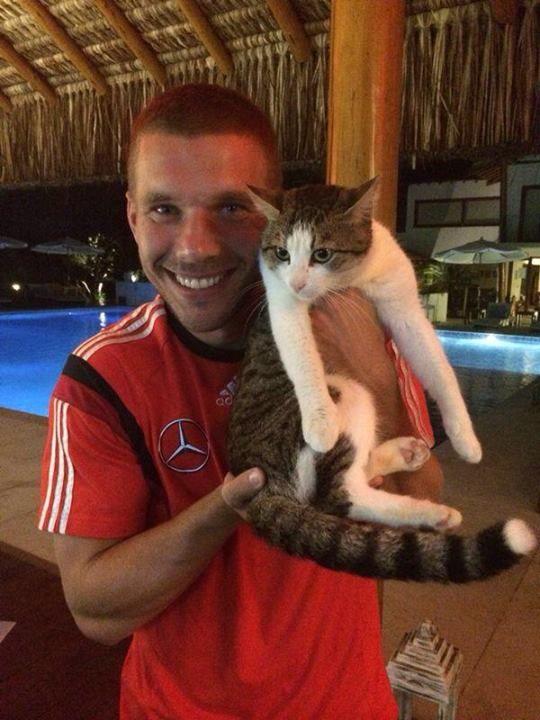 Lukas Podolski and his kitty friend