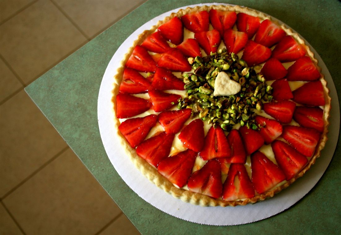 Strawberry and Pistachio Tart. Sub fat-free greek yogurt for the pastry cream if you are trying to cut back on fat.